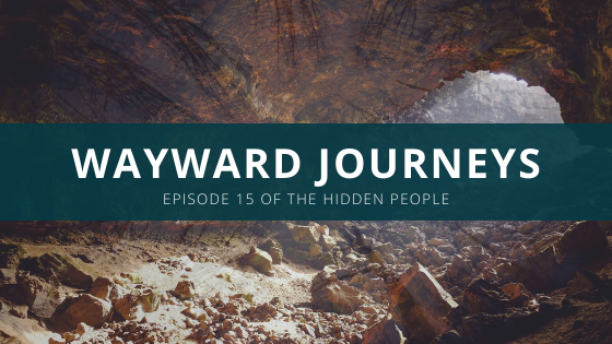 "A large and stony cave is at the foot of an opening to something...perhaps episode 15 of The Hidden People. Along with the c ave we have the usual underlay of the hidden people forest / trees looming in the background and the title of our latest episode in a green bar across it all stating"" Wayward Journeys: Episode 15 of The Hidden People."